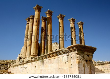 Pillars against Blue Sky at Roman City of Jerash, Jordan  - stock photo