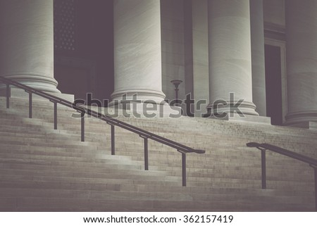 Pillars and Stairs to a Courthouse with Vintage Style Filter - stock photo