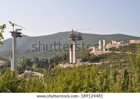 Pillars of a highway construction - stock photo