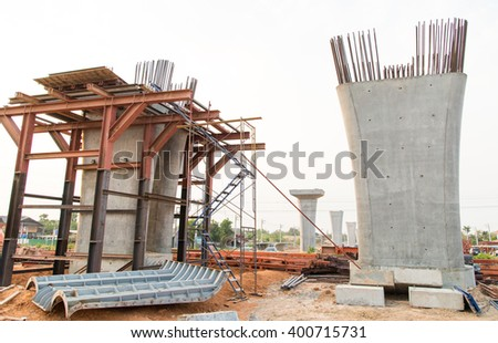 Pillars of bridge under contruction - stock photo