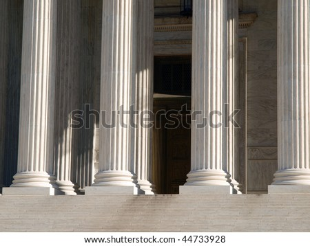 Pillars of justice at the US Supreme Court building in Washington DC. - stock photo