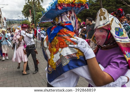 Pilllaro, ECUADOR - FEBRUARY 6, 2016: Unknown locals and tourists dance and celebrate the feast of the diabladas Pillaro.