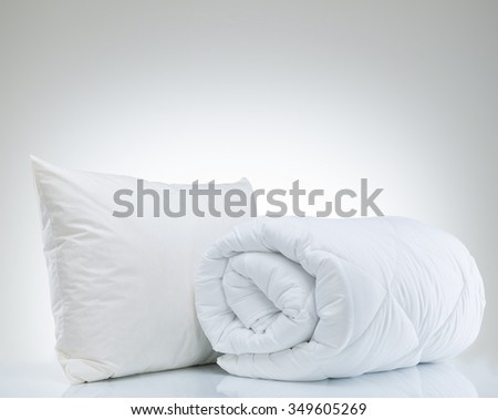 Pillow and quilt - stock photo