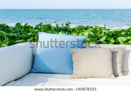 Pillow and the beach - stock photo