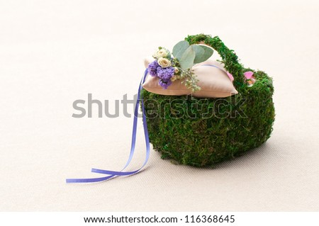pillow for wedding rings in basket - stock photo