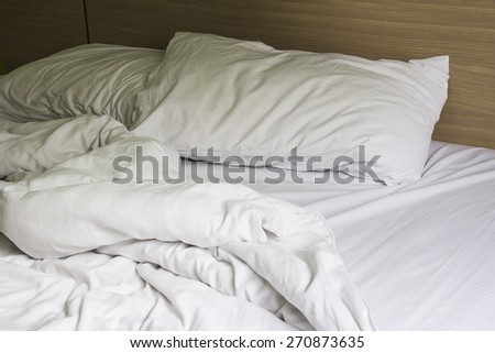 Pillow on bed in the bedroom - stock photo