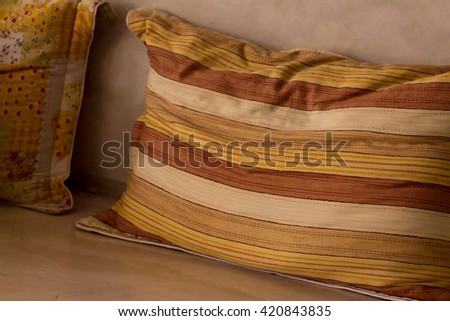 Pillow on chair in dark warm tone  - stock photo