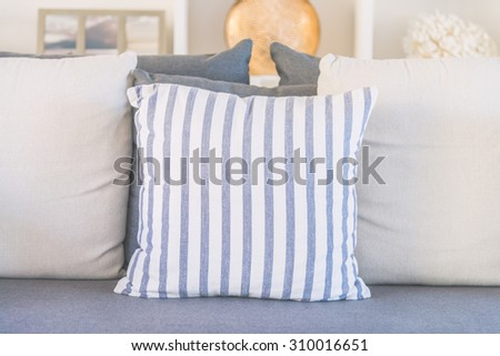 Pillow on sofa bed in living room - light vintage tone filter