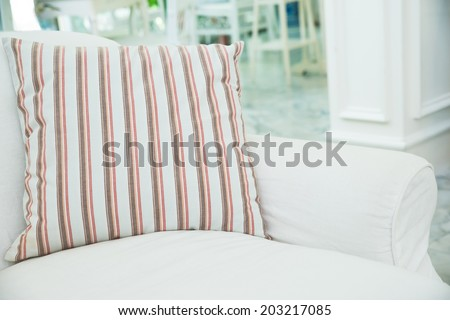 Pillow on white sofa in living room ,Vintage style - stock photo