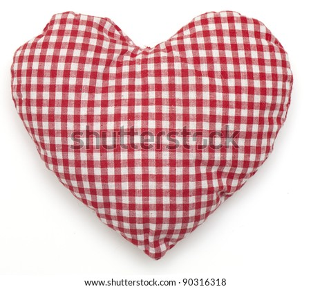 Pillow red and white heart shaped on white