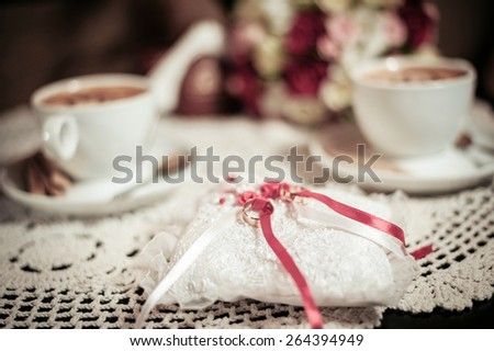 Pillow with wedding rings - stock photo