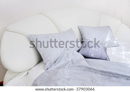 Pillows on a smart white bed in a bedroom
