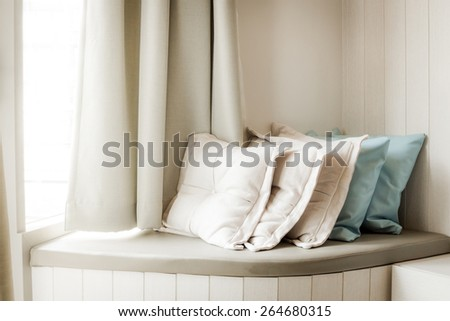 Pillows On Build-In Sofa In The Living Room With Sunlight From The Window : soft filter processed - stock photo