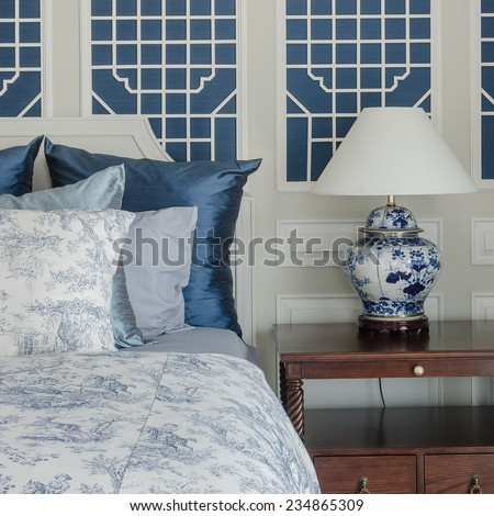 pillows on luxury king size bed with lamp - stock photo