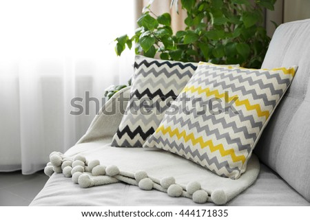 Pillows on sofa in room - stock photo