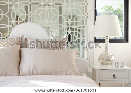 pillows setting on classic style bedding in bedroom. - stock photo