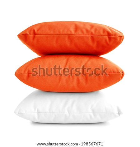 Pillows - stack of three cushions on white background