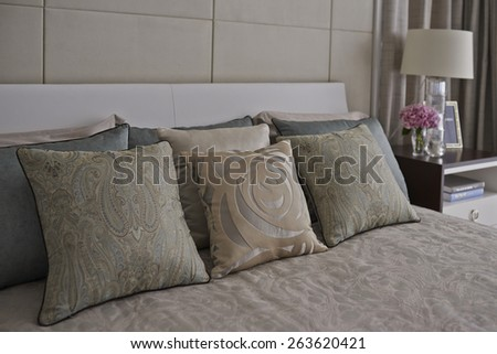 pillows with flower in bedroom interior - stock photo