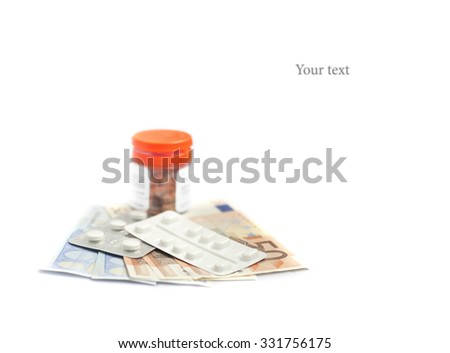 Pills and banknotes : Medical costs concept - stock photo
