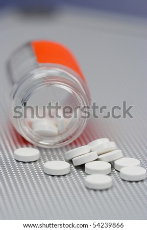 Pills and bottle close-up, shallow dof - stock photo