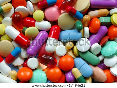 Pills and capsules macro - stock photo