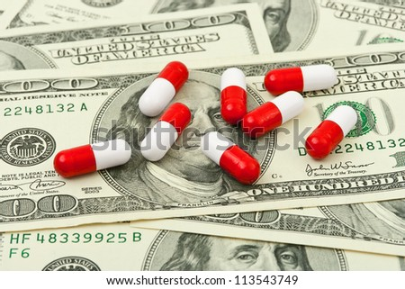Pills and money - business medical background