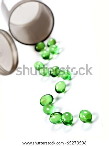Pills and pill bottle - stock photo