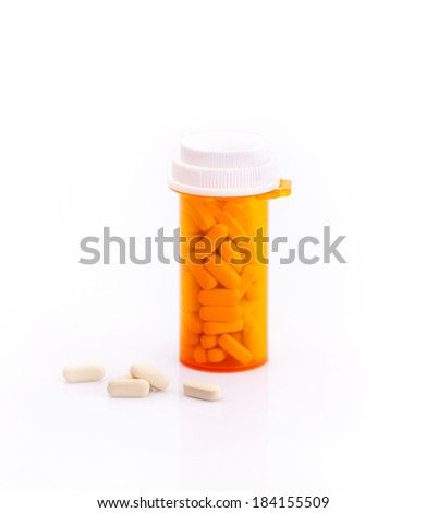 Pills and supplementary food bottle isolated on white background - stock photo