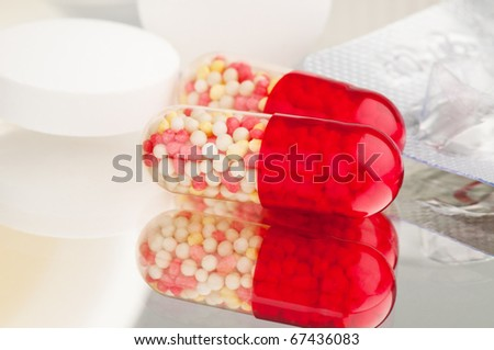 Pills and tablets on the mirror
