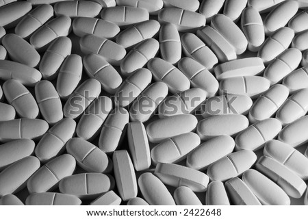 Pills. Background image of many white pills. - stock photo