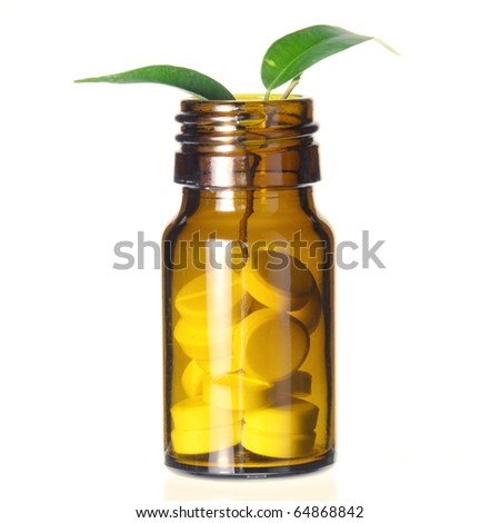 Pills Bottle with Leaf as Alternative Medicine Symbol on White - stock photo