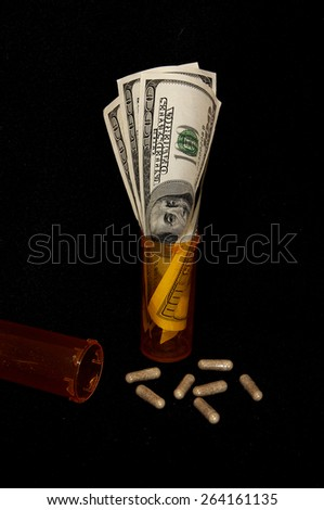 Pills, bottles and cash - stock photo