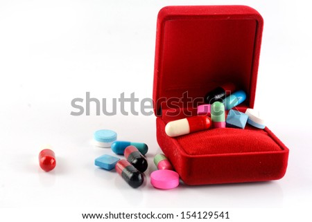 pills capsule in red gift box  - stock photo