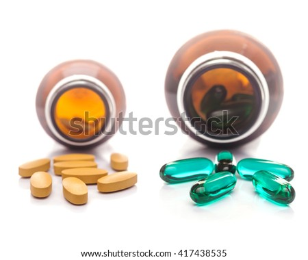 Pills capsule spilling out of a bottle, Selective focus - stock photo