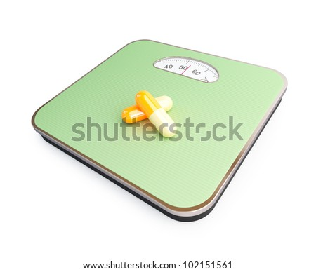 pills for weight loss floor scale on a white background - stock photo