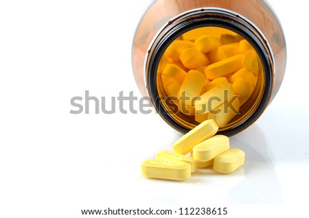 Pills form bottle isolated on whited.