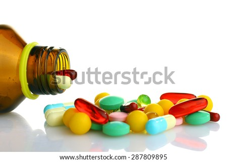Pills from bottle on the white background. - stock photo