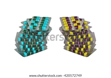 Pills in a blister pack on white background - stock photo