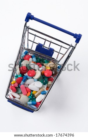 pills in a shopping cart top view