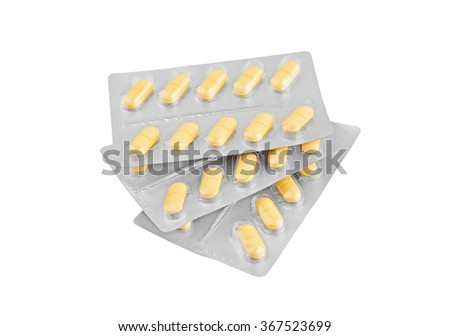 Pills in aluminium blister package, isolated on white background - stock photo