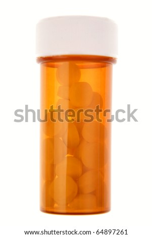 Pills in container on white