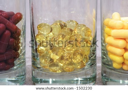 Pills in glass containers - stock photo