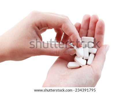 Pills in hand, close-up - stock photo