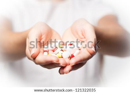 pills in hands - stock photo