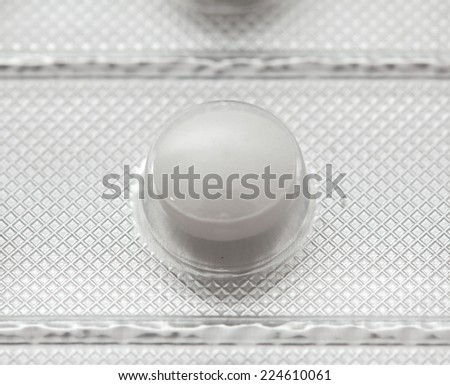 Pills in packing close-up isolated on white background - stock photo