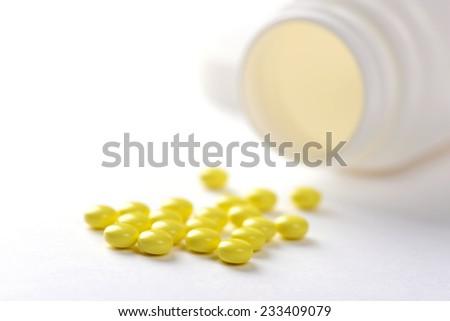 pills in pill bottle on white background - stock photo