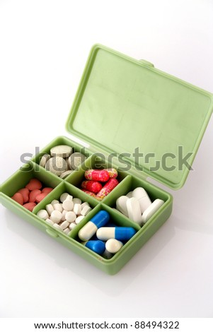 Pills in Pill Box - stock photo