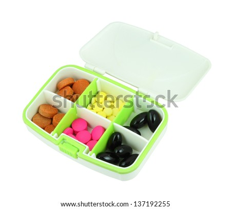 pills in pill box on white background - stock photo