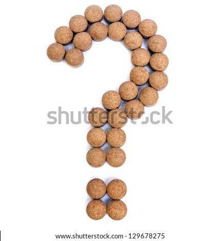 Pills in Question Mark Shape on white Background - stock photo