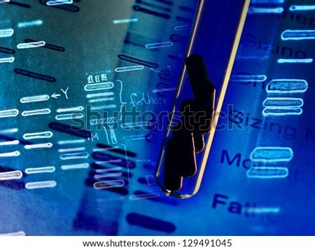 Pills in test tube and DNA fingerprints - stock photo